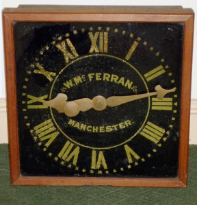 Clock face showing gold leaf numerals and glass dial. Courtesy. J. Shaw.